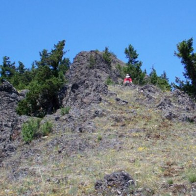 A hiker on the second small peak on Three O'clock Ridge on the way to Maynard Mt