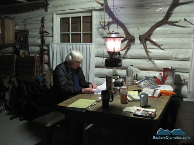 Bruce reads the trail reports