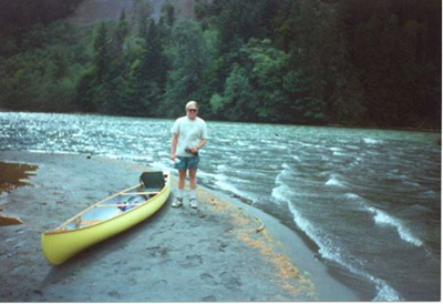 Andy's brother Mike Sallee beside canoe on Lake Mills