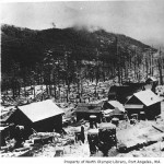 Snow Creek Logging Company camp after a snow - North Olympic Library Photo