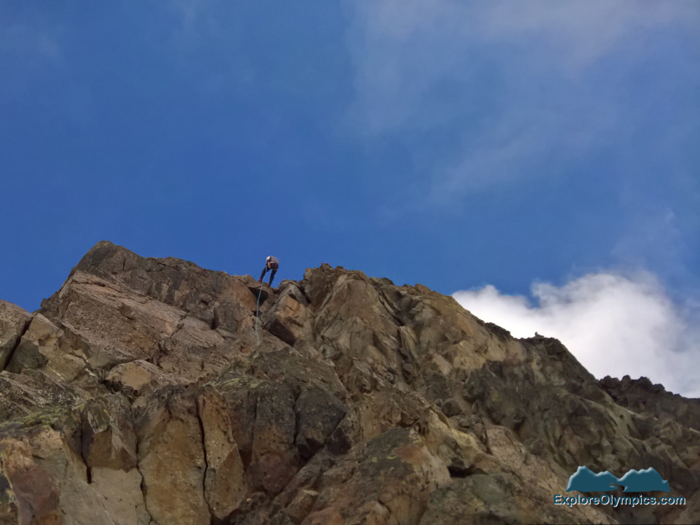Tom repelling off the summit of Mount Olympus