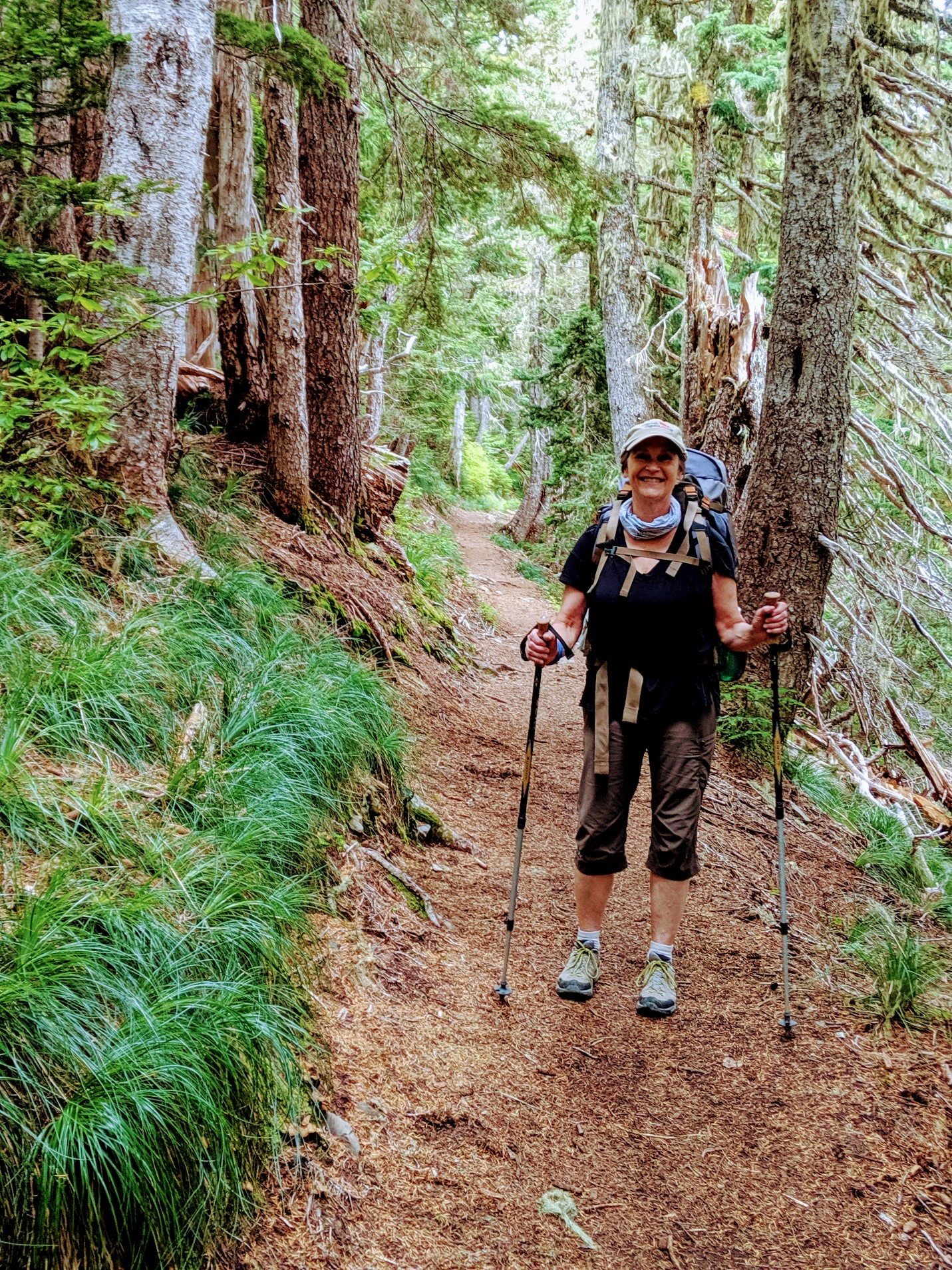 Trisha Wirta with her hiking gear following a trail on the Sole Duck path.