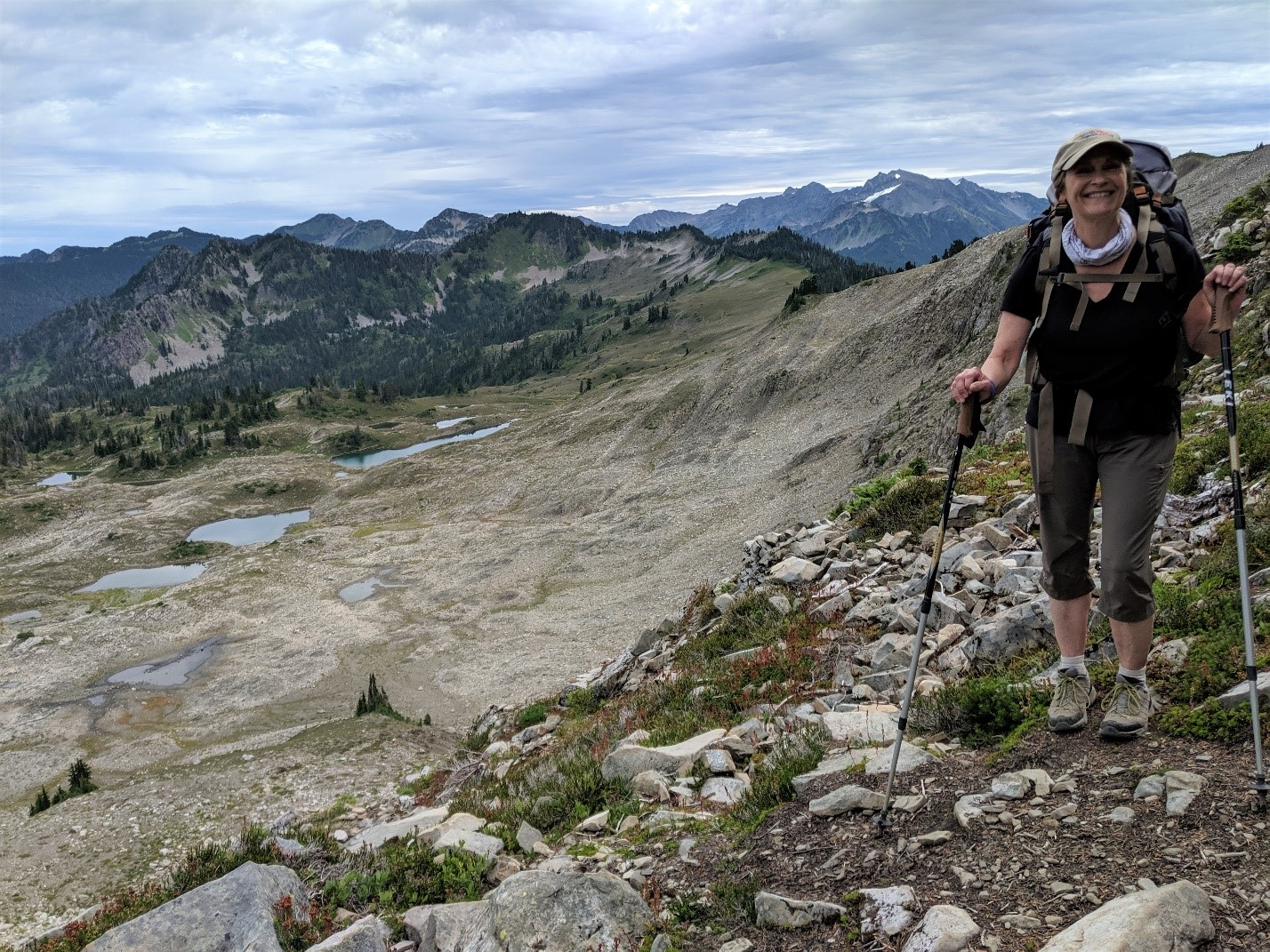 Trisha Wita in her hiking gear with the Seven Lakes Basin in the background