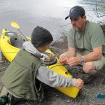 Sean helps a younger fisherman