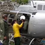 Ranger Sanny and Pilot Doug getting Grant ready for flight
